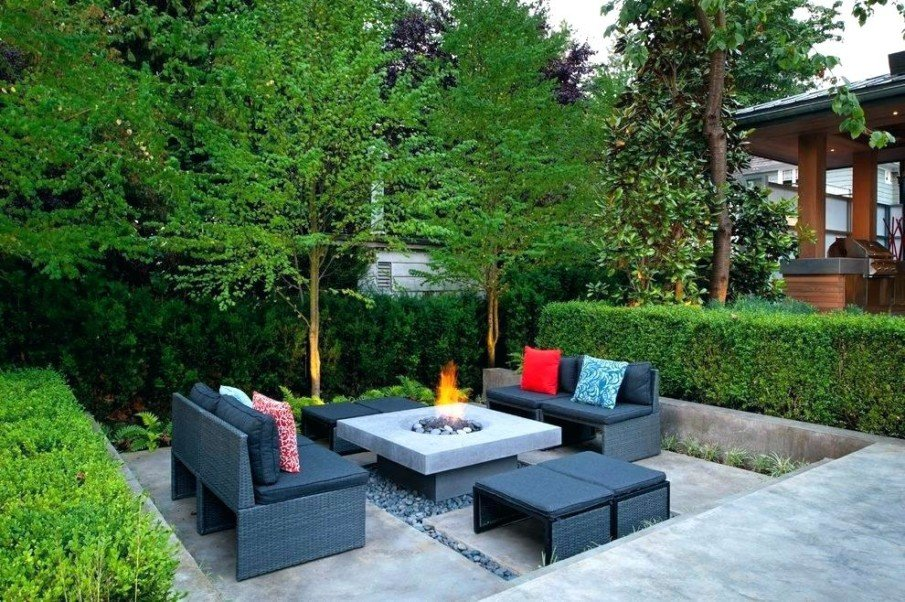 Sunken backyard patio with fireplace and cool furniture