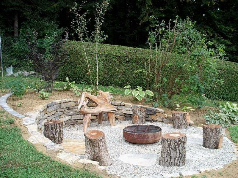 A very inexpensive fire pit setting design for a sloped backyard
