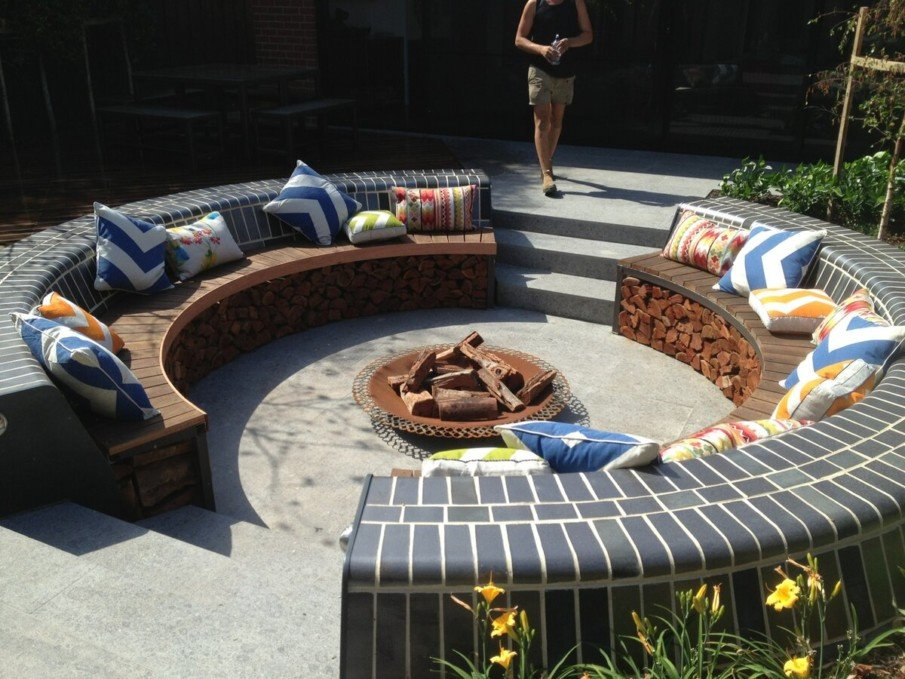 Sunken firepit patio with under bench firewood storage