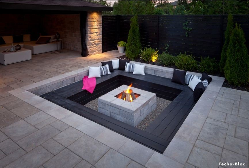 Sunken firepit with built in wood benches