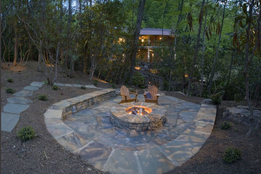 Sunken flagstone patio fire pit idea