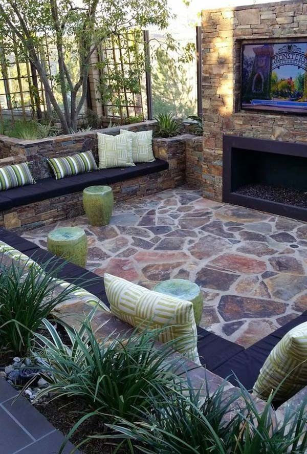 Sunken outdoor fireplace setting with flagstone patio