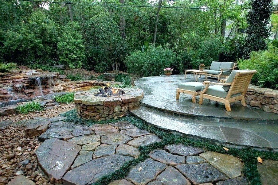 Tiered flagstone patio design with circular sunken fire pit