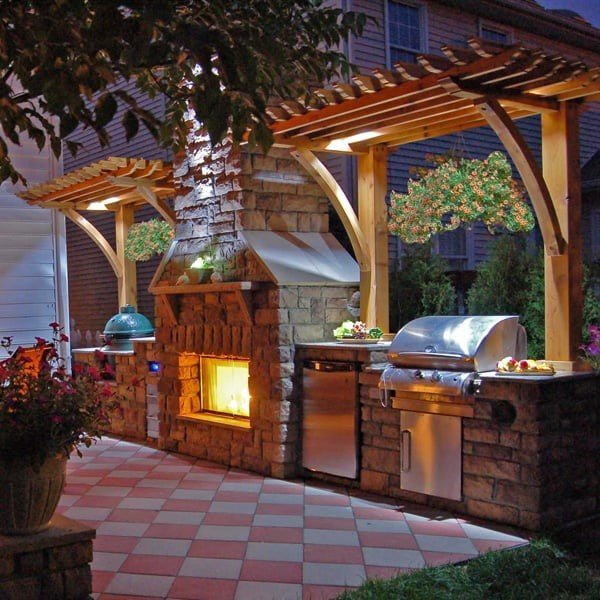 Two decorative pergolas built into an outdoor kitchen