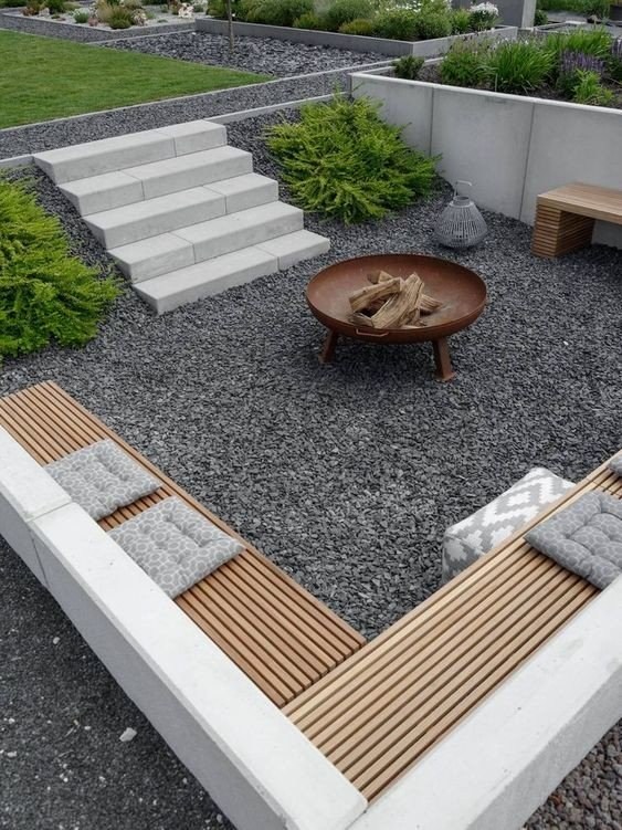 Using natural slope landscape to create sunken firepit patio