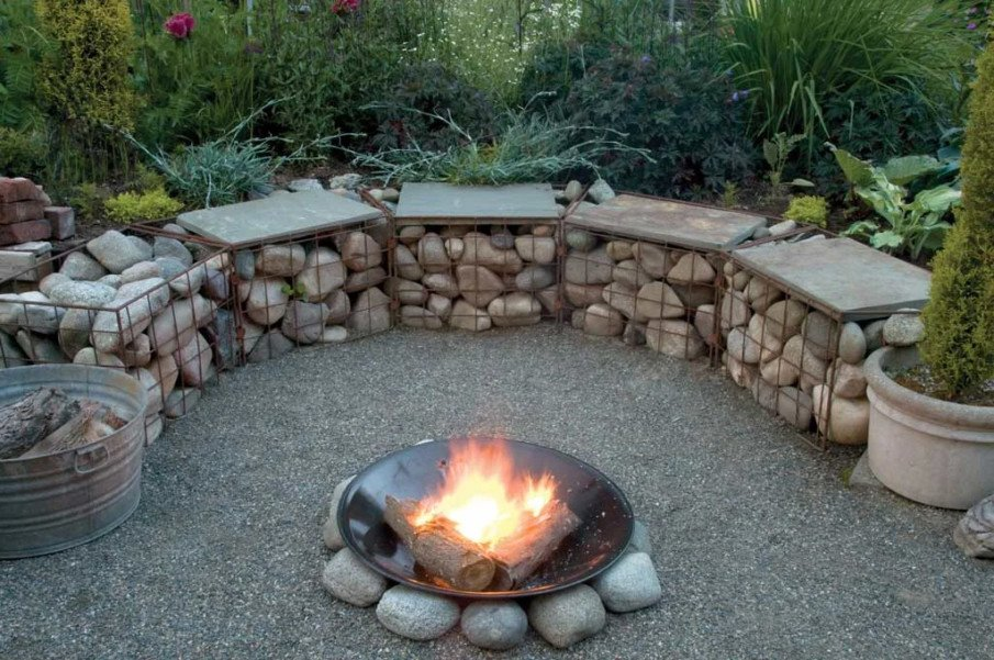 What an unusual fire pit setting idea - using welded wire cages filled with stone as seating