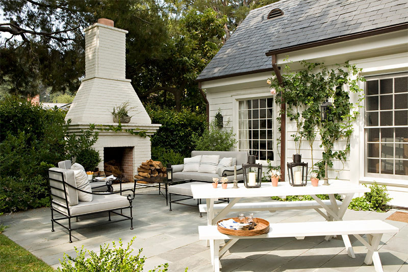 White painted brick fireplace patio design