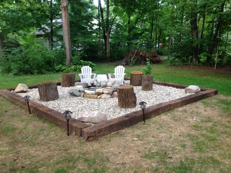 A very simple idea - pour gravel inside a rectangular wooden frame and add tree stump seating