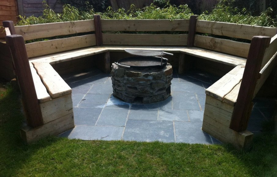 Wood bench circular fire pit seating idea