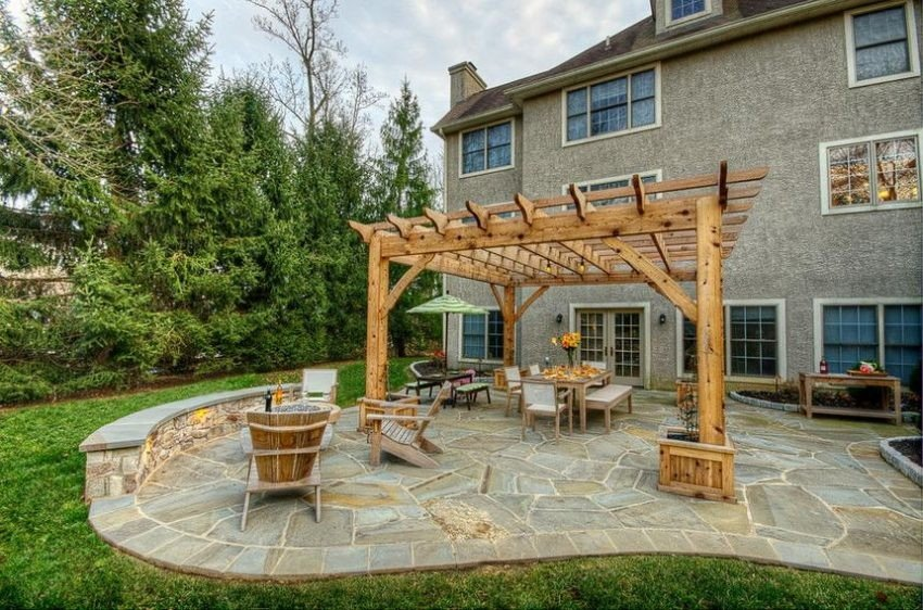 A wood pergola built on flagstone patio idea