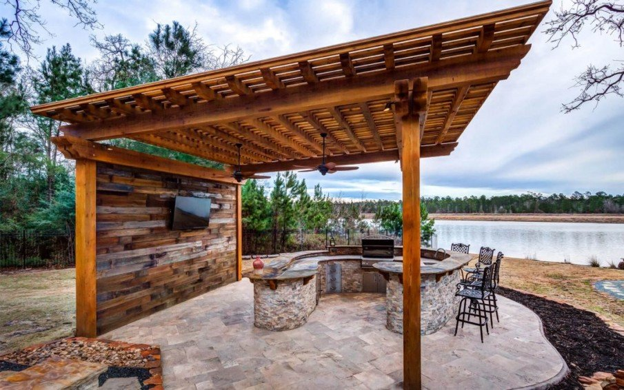 Beautiful custom pergola over outdoor kitchen