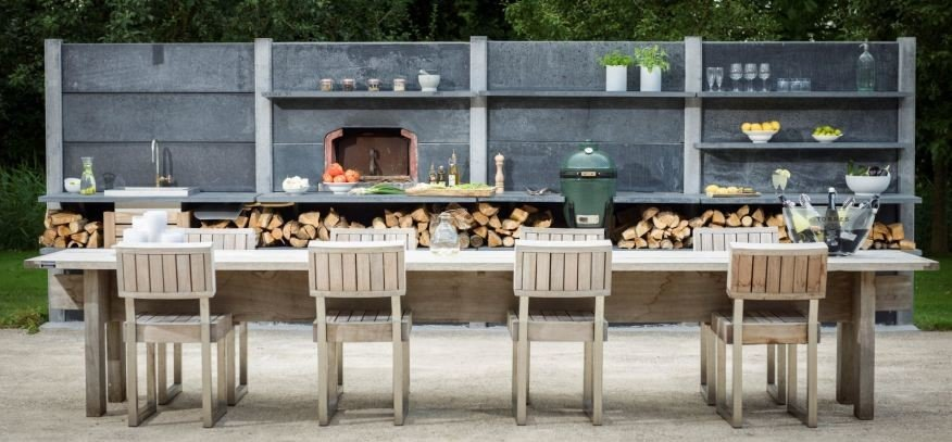 Big green egg built into large wwoo concrete outdoor kitchen