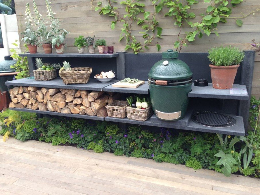 Built-in big green egg in wwoo concrete outdoor kitchen ideas