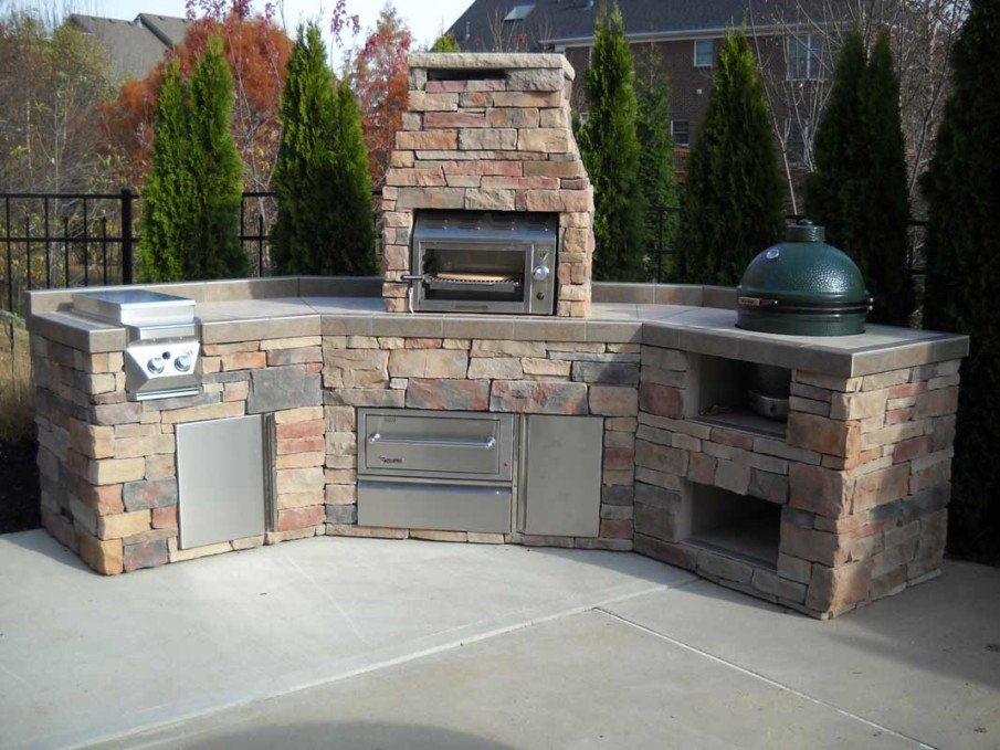 Big green egg outdoor kitchen clad in stone