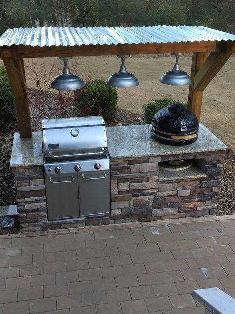 Big green egg outdoor kitchen island with corrugated sheet roof
