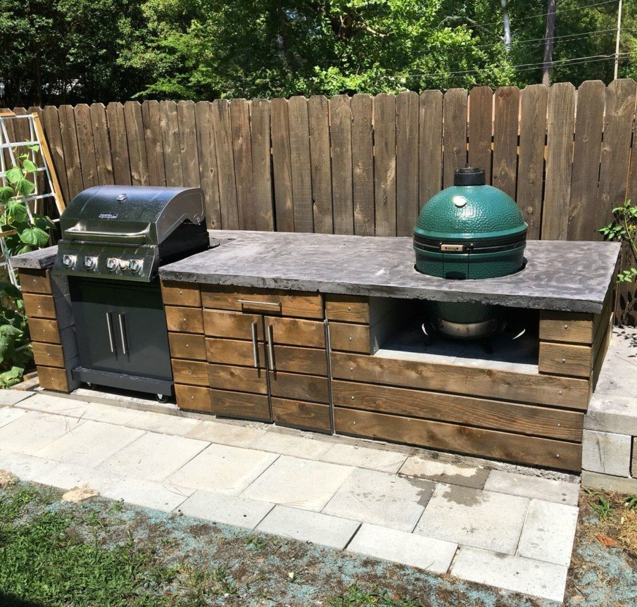 Big green egg outdoor wood kitchen idea