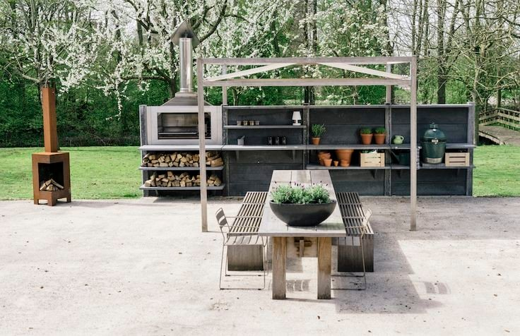 Big green egg in modern wwoo concrete outdoor kitchen