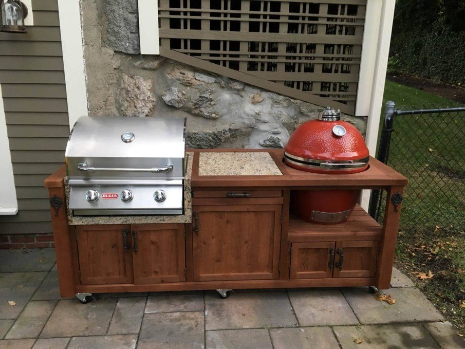 Red big green egg outdoor kitchen island