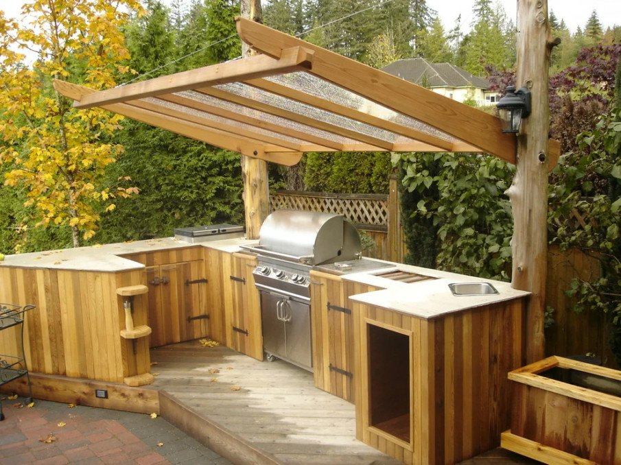Small pergola over outdoor kitchen island