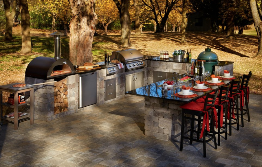 Stunning u-shaped big green egg outdoor kitchen