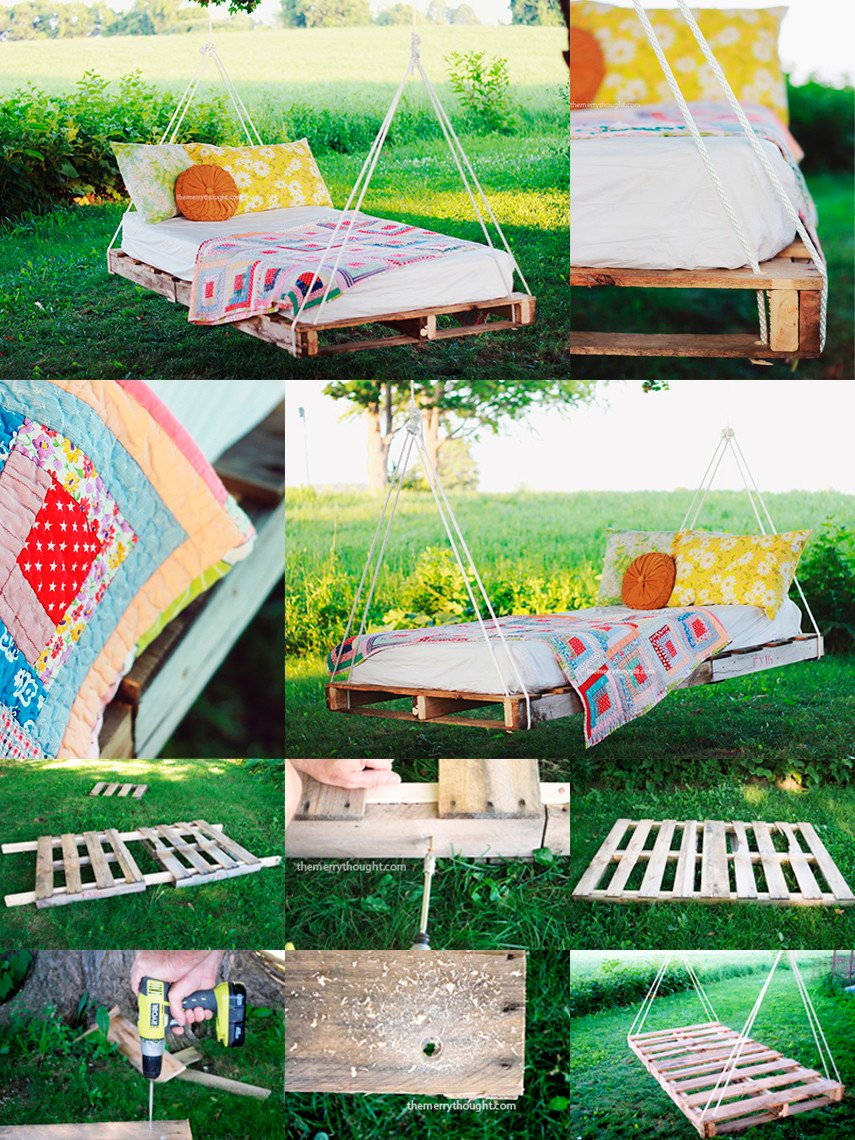 Pallet swing bed hung from a tree