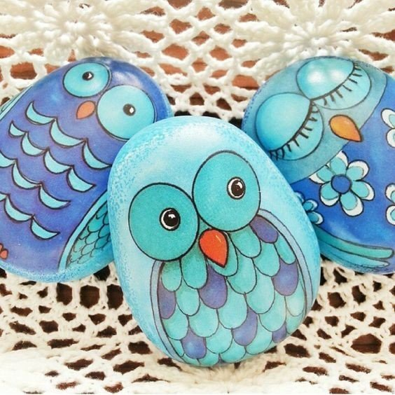 Pebbles painted with owls