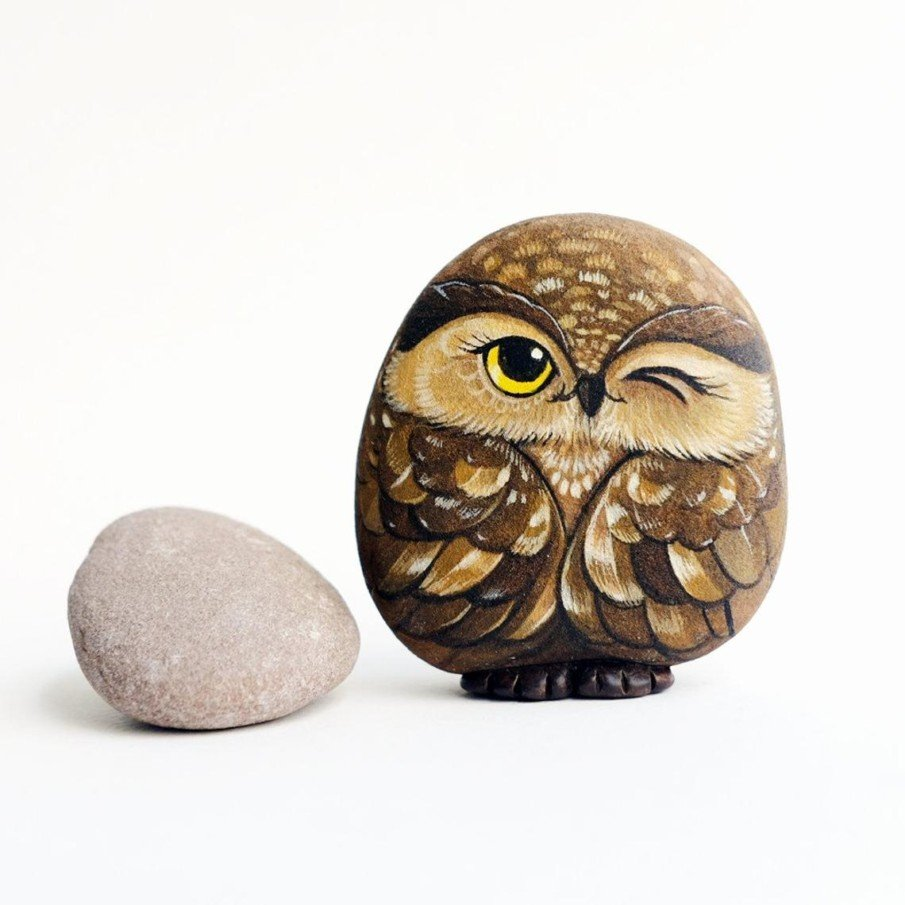 Brown owl painted on rock