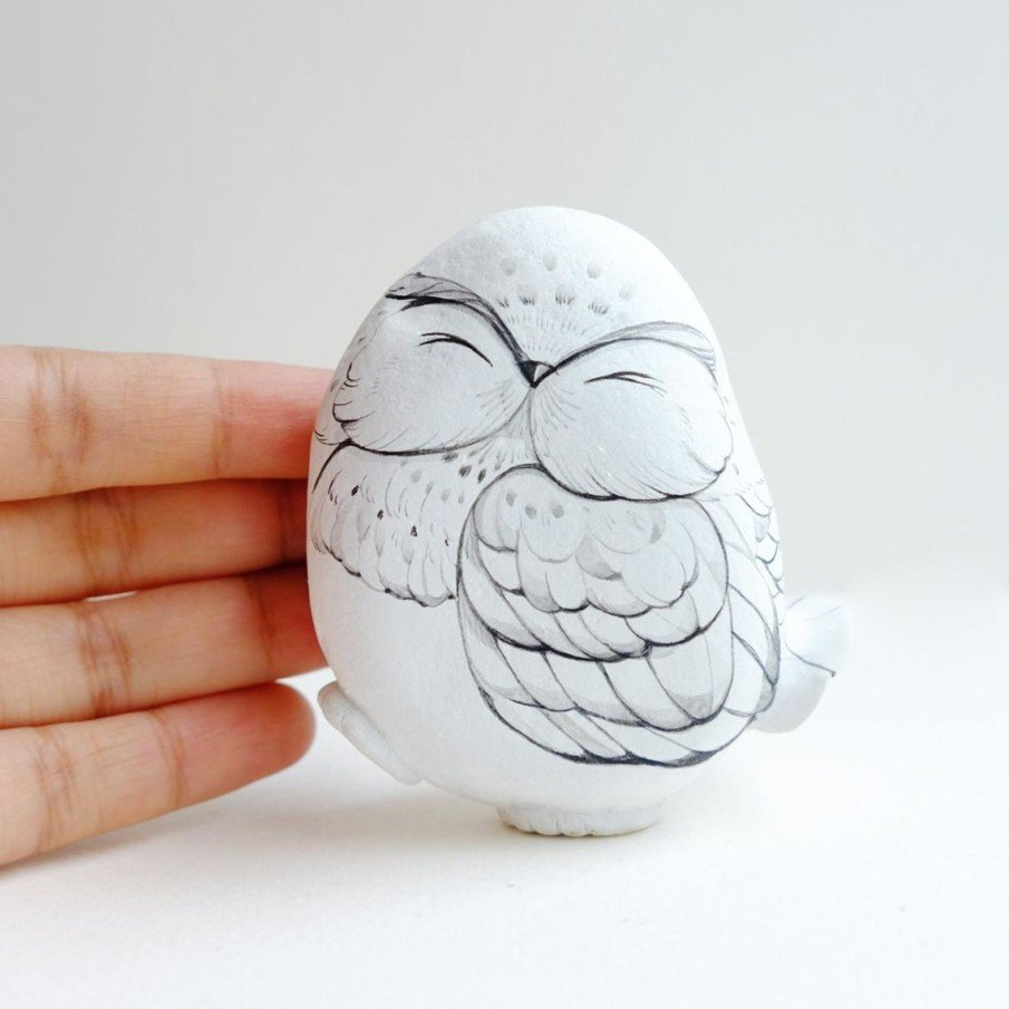 White owl painted on rock