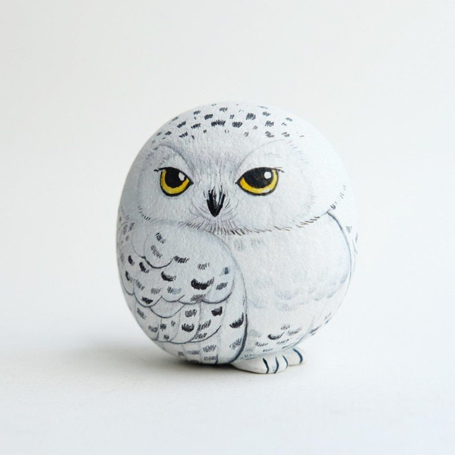 Cute snowy owl rock painting