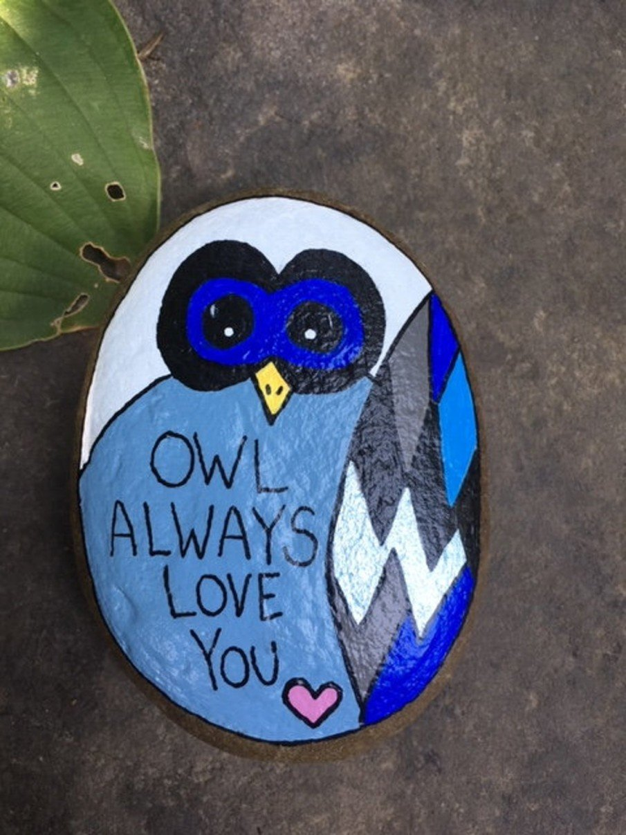 Owl always loves you note painted on a river rock