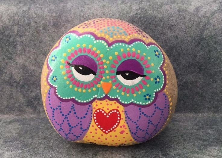Colorful owl rock painting with a red heart