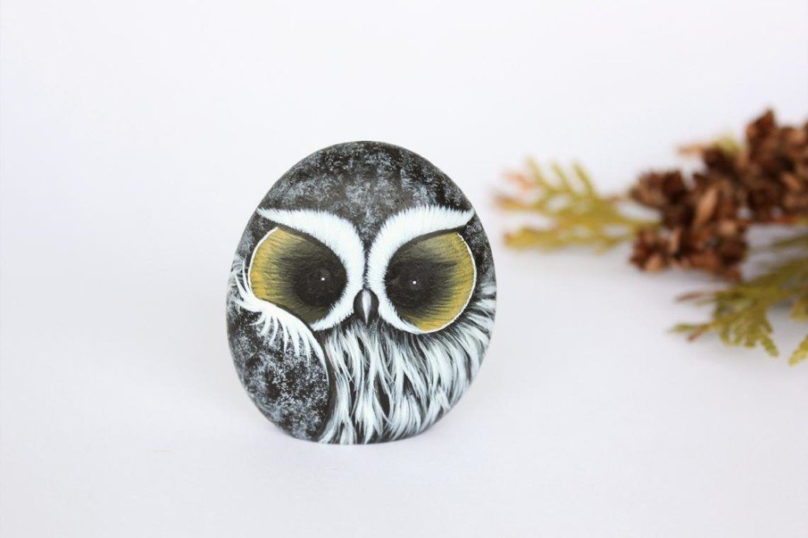 Sleepy owl rock painting