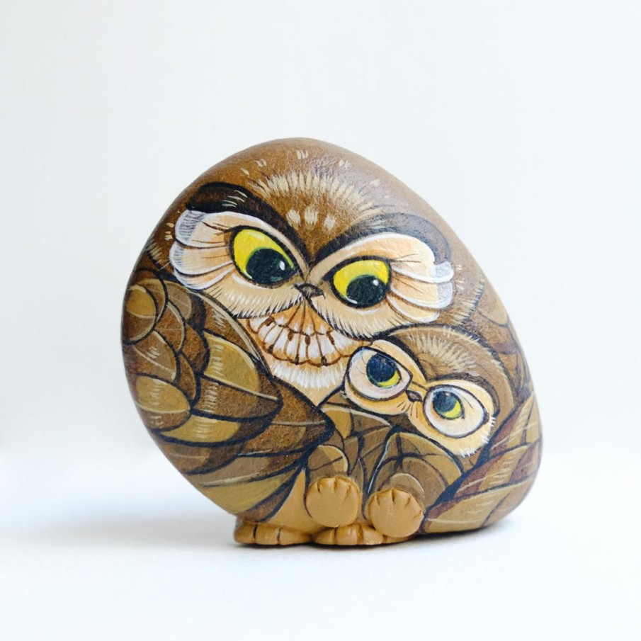 Rock painting of an owl mother and an owl baby