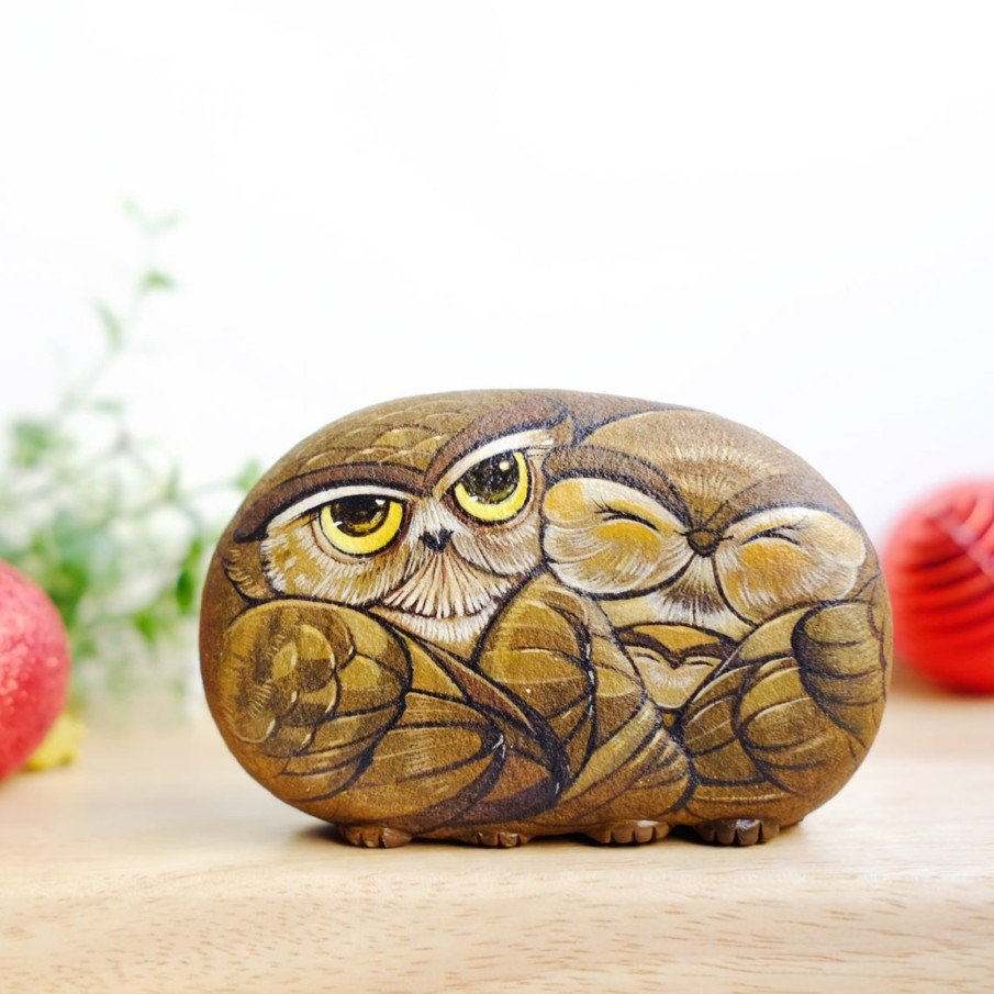 Family of owls painted on rock