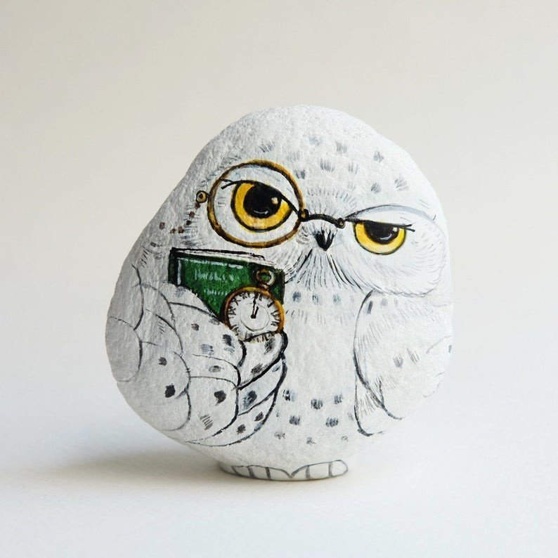 Rock painting of owl with book