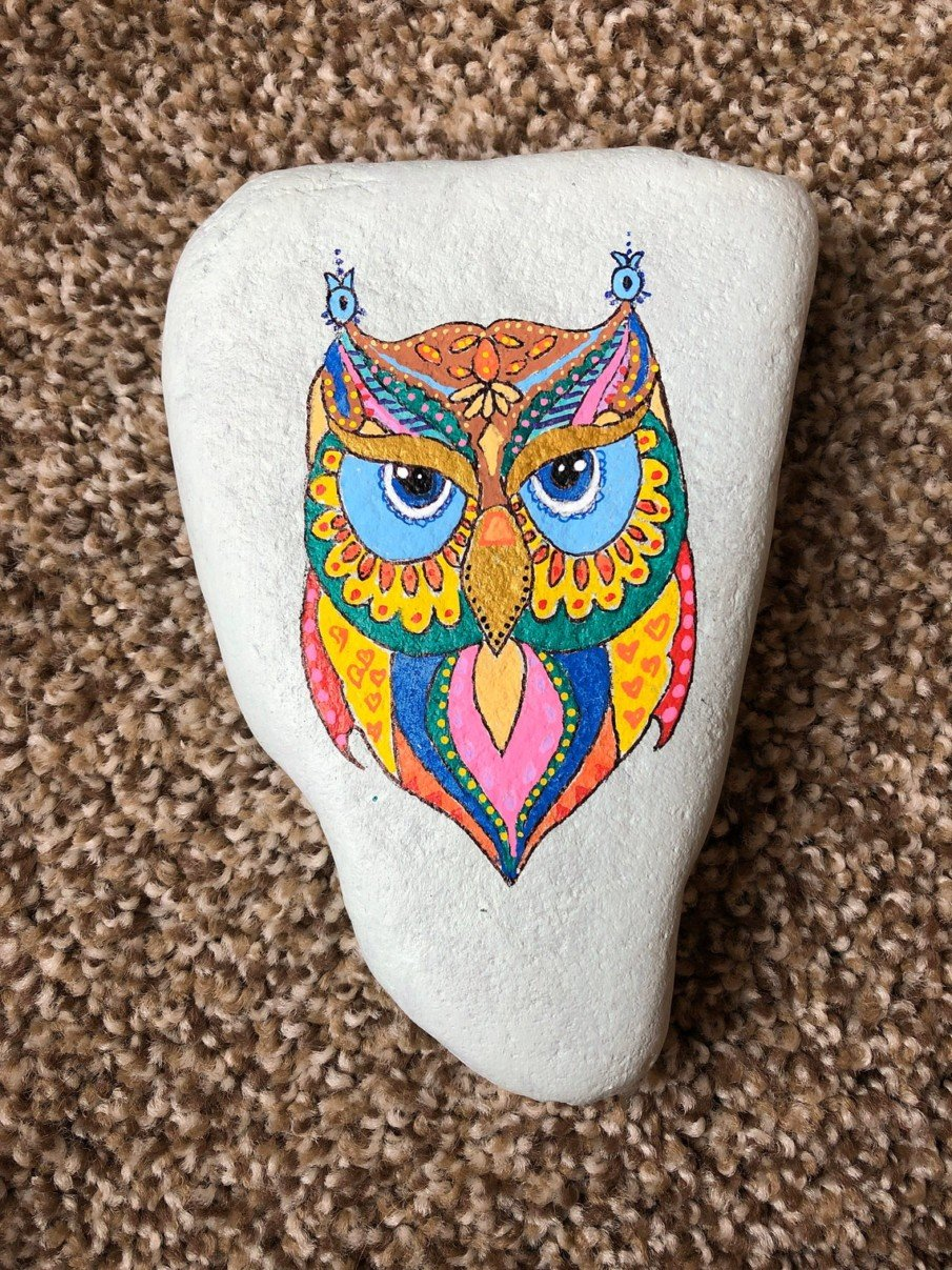 Majestic owl hand painted on river rock