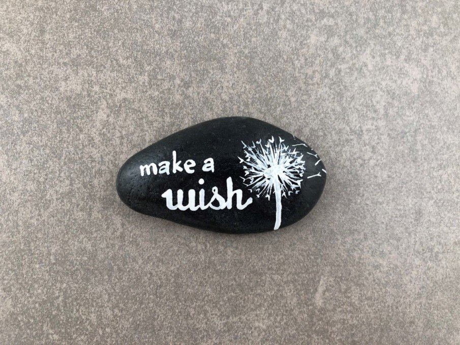 black and white rock painting ideas - making a wish dandelion