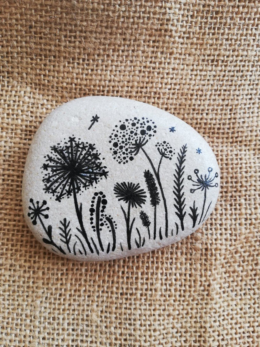 Black painting on a white rock idea - paperweight art