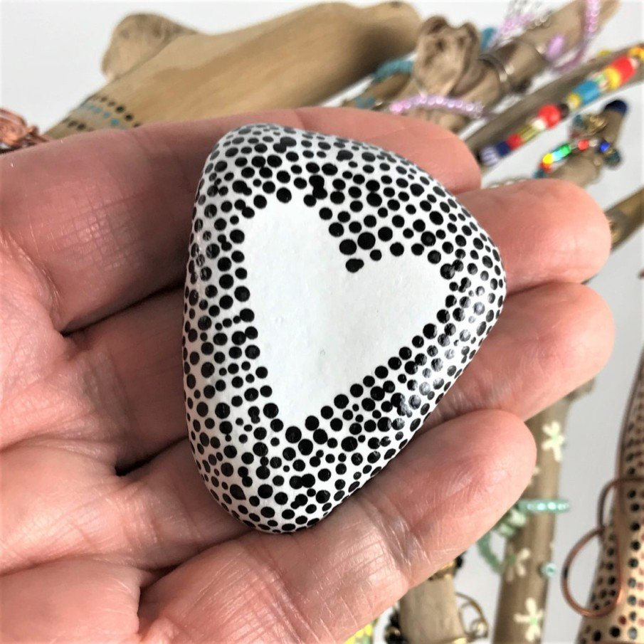Simple black and white rock painting ideas - polka dot art