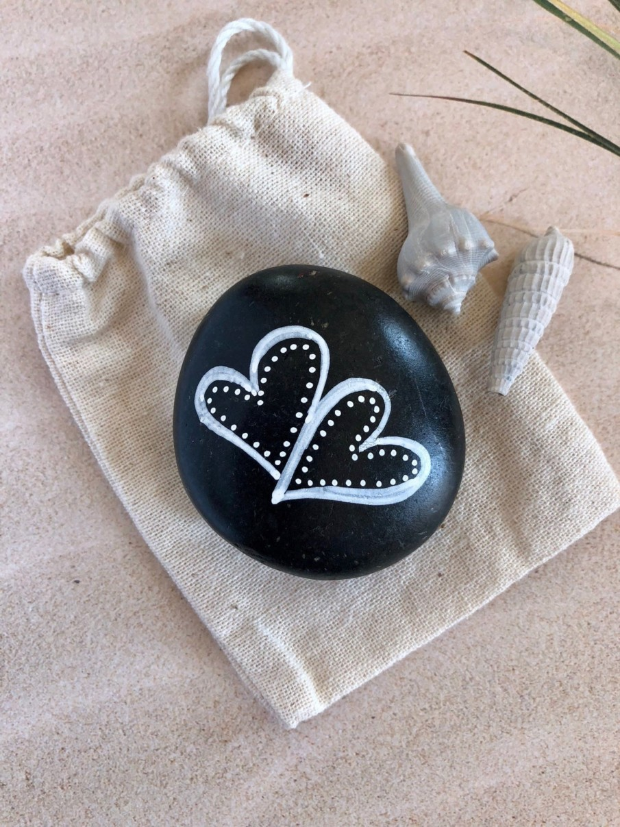 Easy heart painting on a black rock