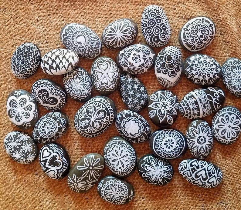 Black and white mandala rock painting