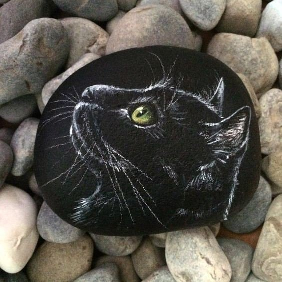 black cat painted on black rock