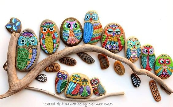 Boho style painted owls on a tree branch art piece