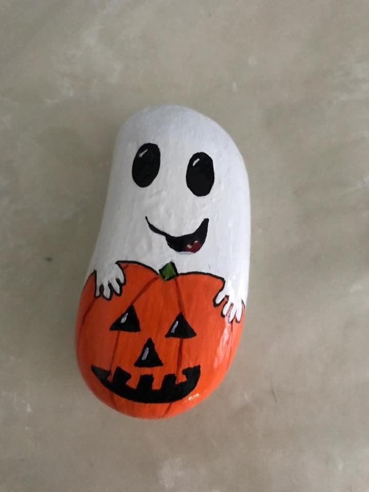 Ghost in pumpkin painted rock