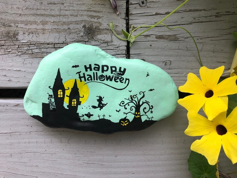 Halloween art painted on a rock