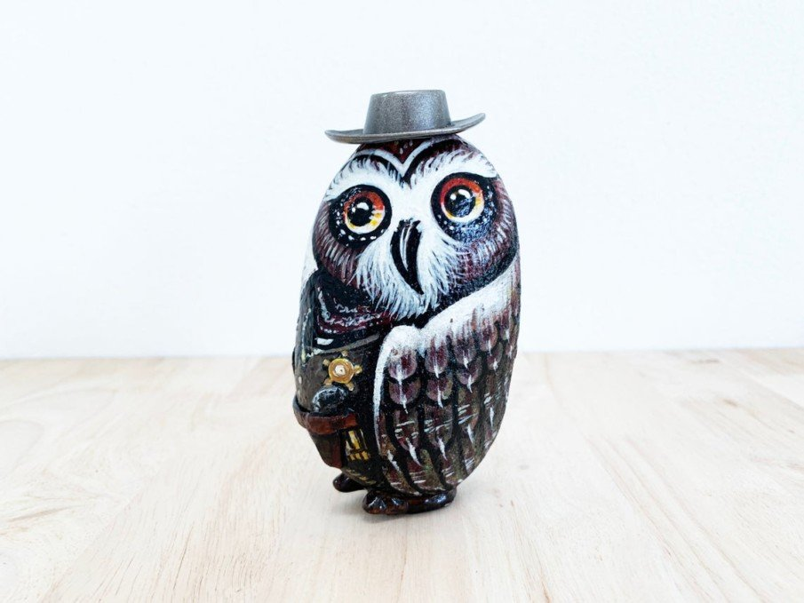 Owl in a hat painted rock