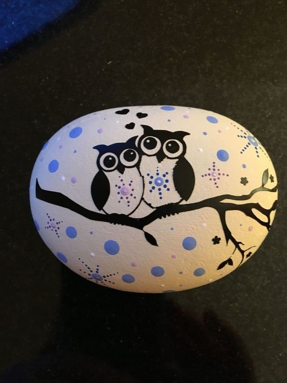 Owl silhouette painted rock