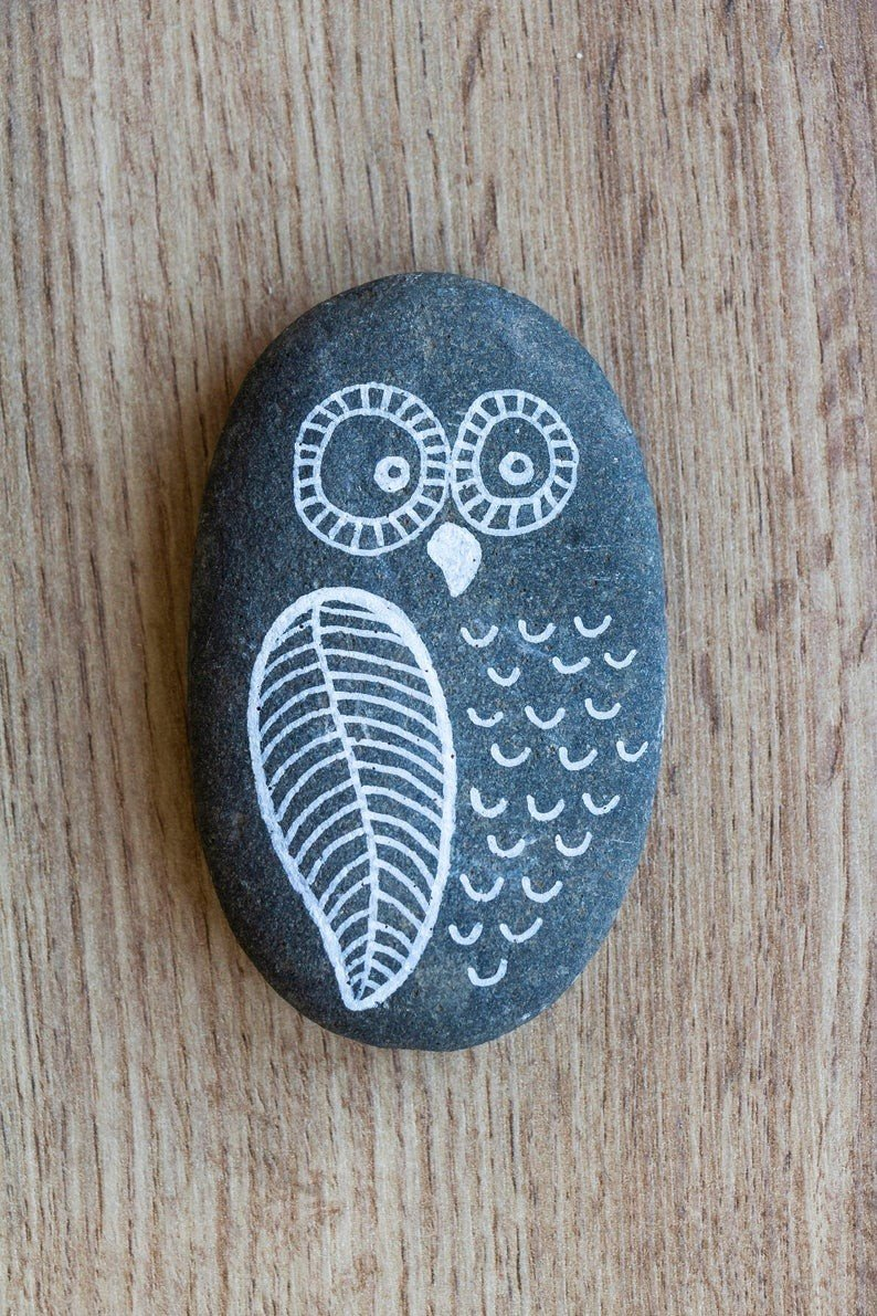 Pebble painted with stylistic owl
