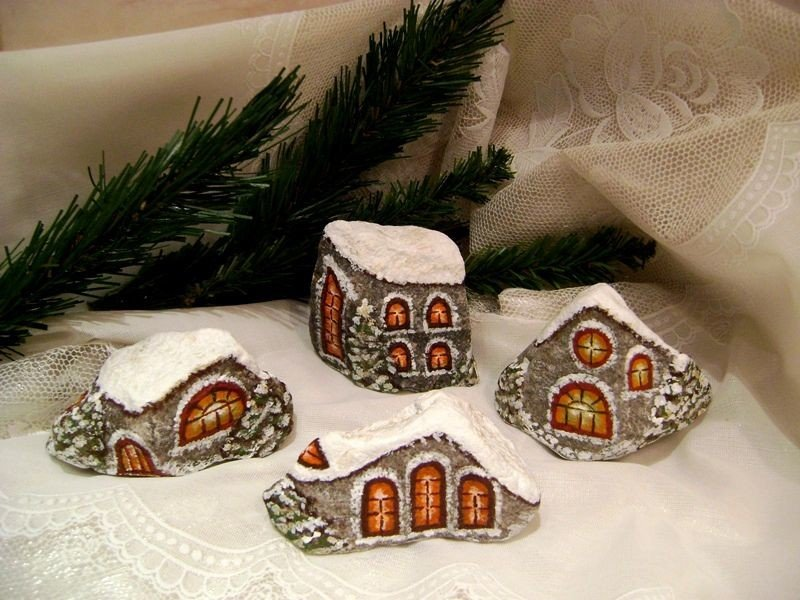 Christmas decorations as painted rock houses