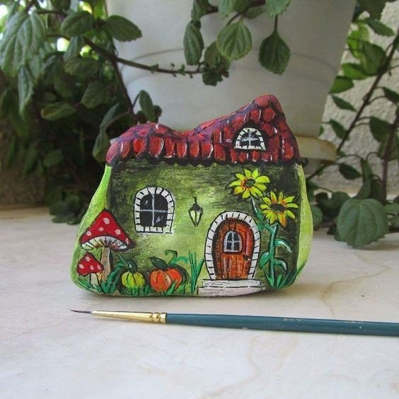 Mushroom cottage painted on a rock